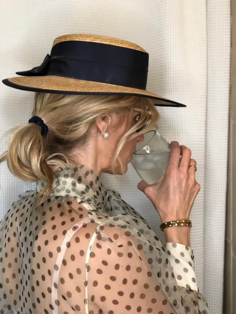 Suz hat drinking water